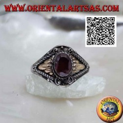 Silver ring with oval garnet and triangular cords with gold plate