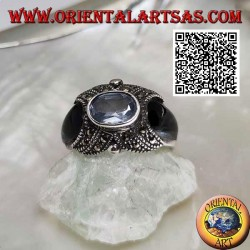 Silver ring with natural oval aquamarine on cross studded with marcasite and onyx on the sides