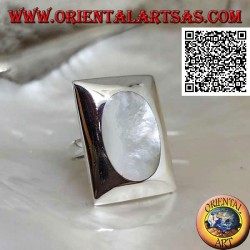 Silver ring with oval mother of pearl flush on a smooth rectangular plate