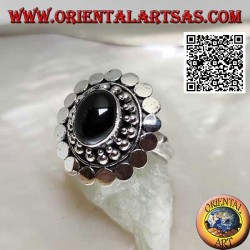 Silver ring with oval cabochon onyx surrounded by balls and discs