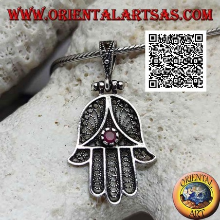 Silver pendant Hand of Fatima with perforated ethnic decoration and set ruby-colored zircon (oxidized)