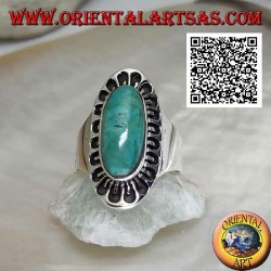 Silver ring with antique Tibetan turquoise elongated oval surrounded by engraved decoration
