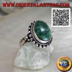 Silver ring with antique oval Tibetan turquoise with balls around and on the sides