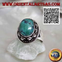 Silver ring with antique oval Tibetan turquoise surrounded by interweaving and ball in the donut