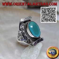 Silver ring with antique oval Tibetan turquoise in Nepalese setting with openwork on the sides