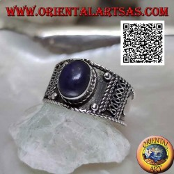 Silver band ring with oval cabochon lapis lazuli and ethnic decorations