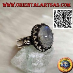 Silver ring with oval rainbow moonstone with tris rim and balls and intertwining