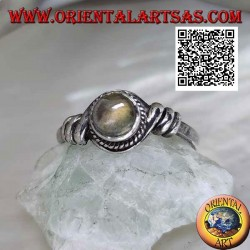 Silver ring with round labradorite in the center of a coiled wire
