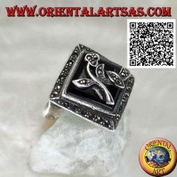 Silver ring with square rhomboid onyx with flower and frame studded with marcasite