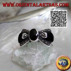 Silver bow tie ring with central oval onyx and onyx and marcssite on the sides