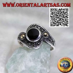 Silver ring with round onyx wrapped in a marcasite band with a gold-plated ball on the sides