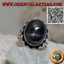 Silver ring with set oval Black Star and high edge with discs