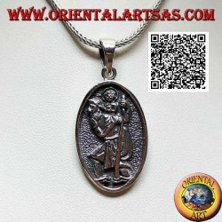 Silver pendant, sacred oval medal with St. Christopher with stick and child in bas-relief