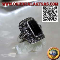 Silver ring with baguette cut onyx on rectangular frame and hooks studded with marcasite