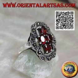 Silver ring with 4 oval garnets arranged in a cross and openwork frame of marcasite