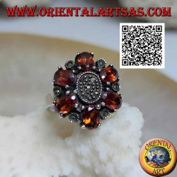 Silver flower ring with 6 oval mandarin garnets (Spessartina) and central marcasite