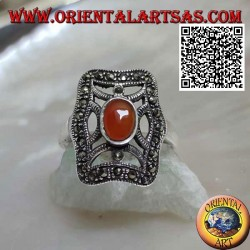 Silver ring with oval carnelian on cross in the irregular rectangle studded with marcasite