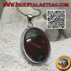 Silver pendant with large oval brecciated red jasper surrounded by weaving