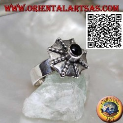 Silver ring in the shape of a pagoda umbrella with a central round onyx