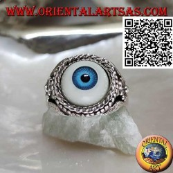 Silver ring with eye with blue pupil surrounded by interweaving