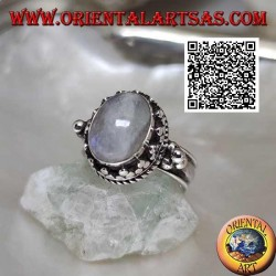 Silver ring with oval rainbow moonstone surrounded by trio of discs and intertwining