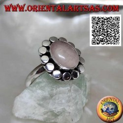 Silver ring with oval rose quartz surrounded by smooth discs
