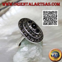 Oval silver ring with three levels of marcasite with a trio of round onyx on top