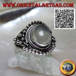 Silver ring with oval moonstone on ethnic setting decorated with intertwining and balls