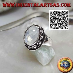Silver ring with oval moonstone surrounded by interweaving and ball in the donut