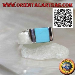 Smooth silver ring with square turquoise set flush with the edge on a rectangular plate