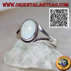 Silver ring with natural oval cabochon harlequin opal on solitaire style setting