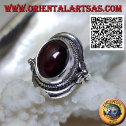 Silver shield ring with oval cabochon garnet surrounded by interweaving and clover on the sides