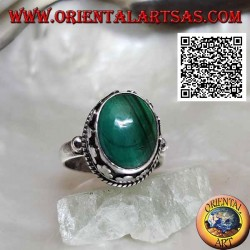 Silver ring with raised oval malachite surrounded by interlacing and discs