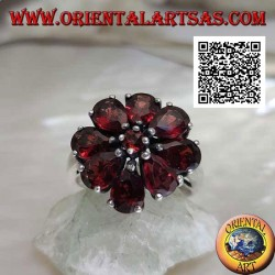 Silver flower ring with set garnets, central round and teardrop petals