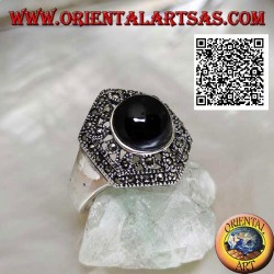 Hexagonal silver ring with openwork decoration studded with marcasite with central round onyx