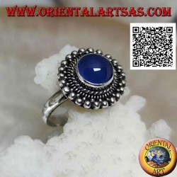 Silver ring with cabochon round blue agate surrounded by interlacing and balls