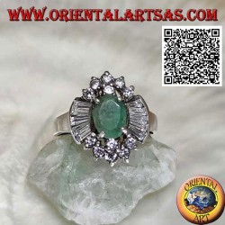 Silver ring with natural oval emerald set surrounded by round and trapezoid zircons