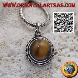 Silver pendant with round tiger eye with vertical streaks surrounded by weaving