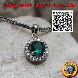 Silver pendant with faceted round emerald zircon surrounded by white zircons