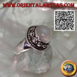 Silver ring with round moonstone surrounded by interweaving and ball in the donut