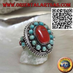 Nepalese style silver ring with natural oval coral and turquoise spheres in the frame and on the sides
