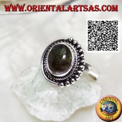 Silver ring with oval labradorite surrounded by intertwining and balls only on one half