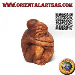 10 cm sculpture of a couple in consoling embrace in suar wood