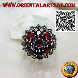 Silver ring with oval garnet surrounded by round and oval garnets in a sun of marcasite