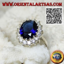Silver ring with oval faceted synthetic sapphire set surrounded by white zircons