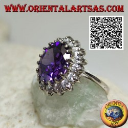 Silver ring with faceted oval synthetic amethyst set surrounded by white zircons
