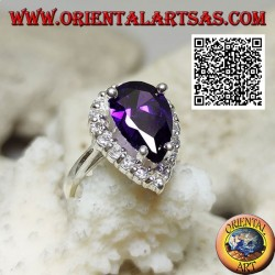 Silver ring with synthetic faceted drop amethyst set surrounded by white zircons
