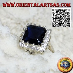 Silver ring with faceted square synthetic sapphire set surrounded by white zircons
