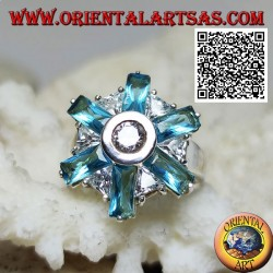 Silver ring with six petals of blue topaz and alternating central white zircons