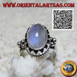 Silver ring with oval cabochon rainbow moonstone surrounded by trio of discs and weaving